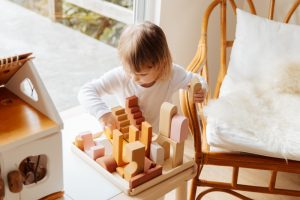 Canva – Photo Of Child Playing With Wooden Blocks